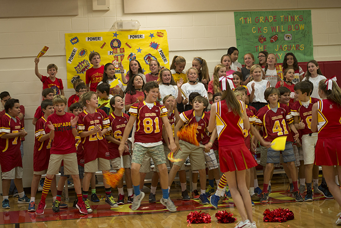 Cheerleaders lead Christ the King Catholic School students in celebrating the announcement that the campus was recognized as a 2015 National Blue Ribbon School of Academic Excellence. (JENNA TETER/The Texas Catholic)