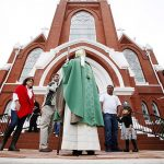 Bishop Kevin J. Farrell greets parishioners outside of St. Patrick Catholic Church, following a Mass celebrating completion of the parish's 2nd Century Restoration project on Oct. 25 in Denison. (Ben Torres/Special Contributor)