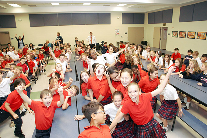 All Saints Catholic School students react upon hearing that their school was named a recipient of the National Blue Ribbon award on Sept. 29.