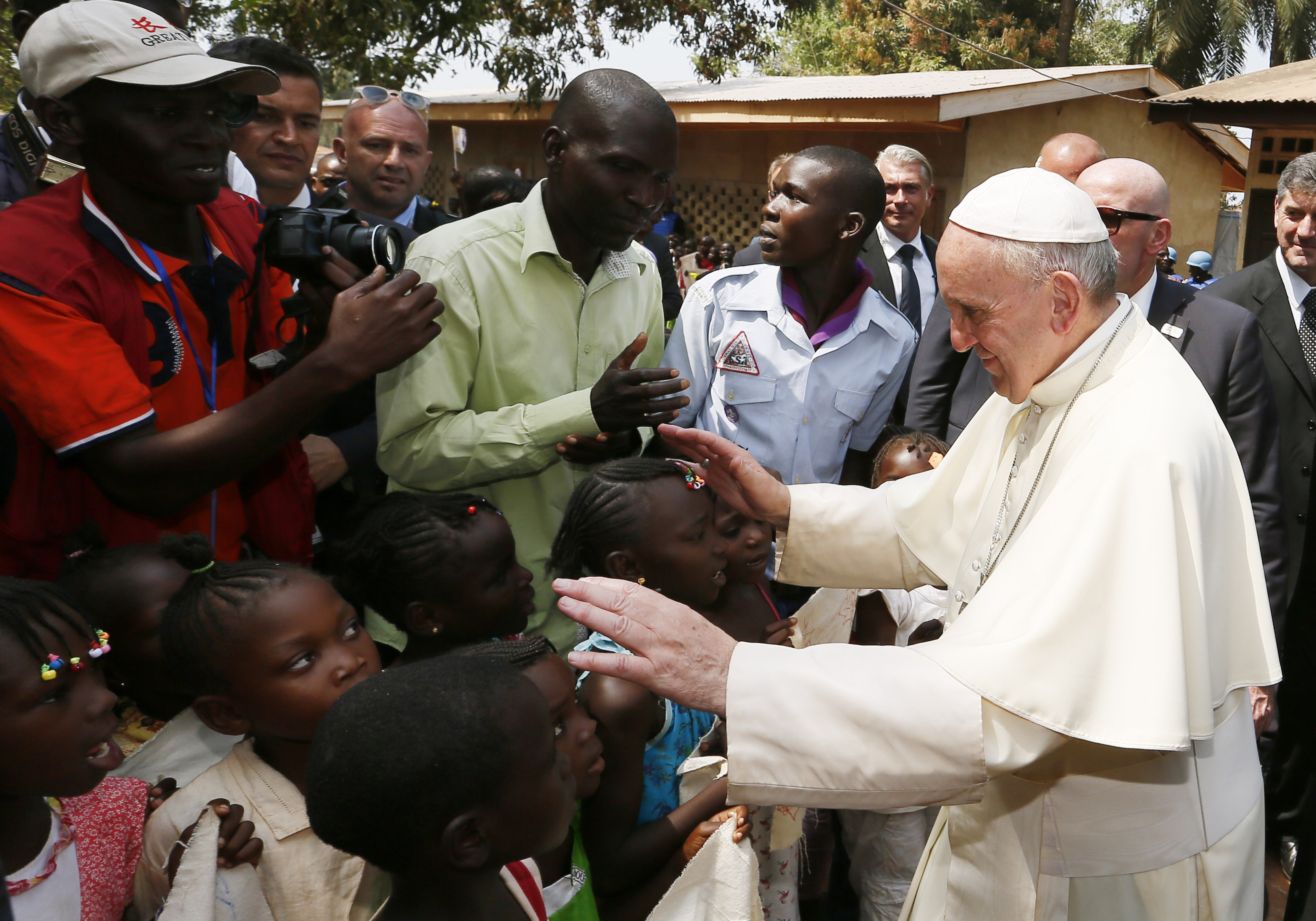 Pope Francis greets children as he visits a refugee camp in Bangui, Central African Republic, Nov. 29. (CNS photo/Paul Haring)
