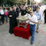Father Marco Rangel, left, leads a group of catholic volunteers as they escort the relics of St. Maria Goretti during The Pilgrimage of Mercy, the tour of the major relics of St. Maria Goretti, at St. Monica Catholic Church on Nov. 3 in Dallas. (Ben Torres/Special Contributor)