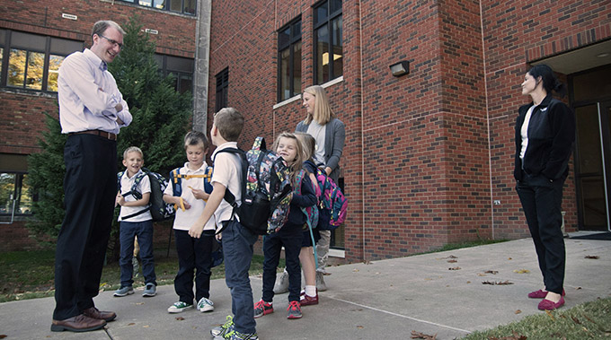 JENNA TETER/The Texas Catholic Matt Vereecke, who in January will step into the role of superintendent of Dallas Catholic Schools, visits with students outside of Monte Cassino School in Tulsa, Okla., on Nov. 3. Vereecke currently serves as the director of the Tulsa school, which is the largest Catholic elementary school in Oklahoma. (JENNA TETER/The Texas Catholic)