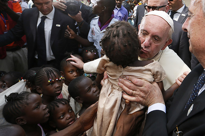 Pope Francis kisses a child as he visits a refugee camp in Bangui, Central African Republic, Nov. 29. (CNS photo/Paul Haring)