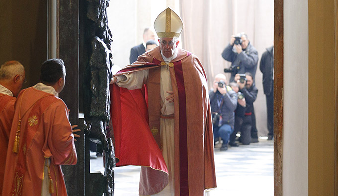 Pope Francis opens the Holy Door of the Basilica of St. John Lateran in Rome Dec. 13. Holy doors around the world were opened at city cathedrals, major churches and sanctuaries Dec. 13 as part of the Jubilee of Mercy. (CNS photo/Paul Haring)