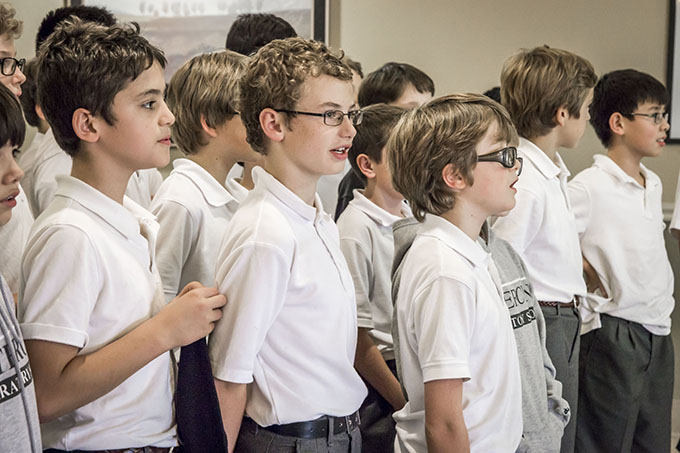 Fifth-grade students from Cistercian Preparatory School sing Christmas carols at the Northgate Plaza nursing home in Irving on Dec. 11. (RON HEFLIN/Special Contributor)