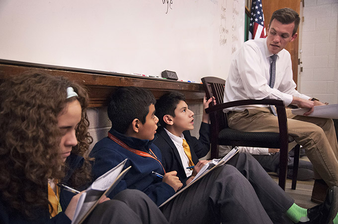 Kenndrick Mendieta, middle, participates in Timothy Woodward's literature class at Cristo Rey Dallas College Prep in Pleasant Grove. (JENNA TETER/The Texas Catholic)