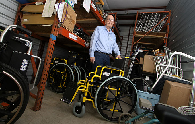 Bishop's Award for Service recipient John Blanks is surrounded by some of the wheelchairs and mobility devices he refurbishes in Garland on Jan. 14. Blanks has two storage units filled with wheelchairs, walkers, crutches and other devices awaiting repair and distribution. (KEVIN BARTRAM/Special Contributor)