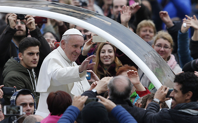 Pope Francis greets the crowd as he arrives to lead his general audience in St. Peter's Square at the Vatican Feb. 3. (CNS photo/Paul Haring)