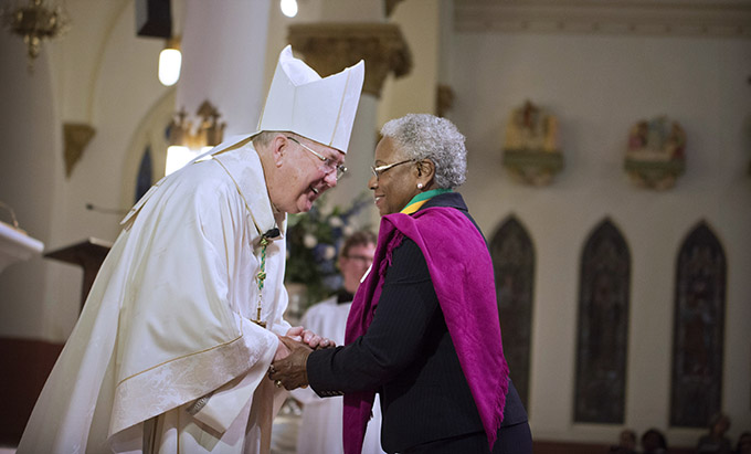 Bishop Kevin J. Farrell thanks Kate Gary of Holy Cross Catholic Church for her service to the church Jan. 30 at the Cathedral Shrine of the Virgin of Guadalupe. (JENNA TETER/The Texas Catholic)