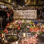 People gather at Place de la Bourse March 22 to pay tribute to the victims of the bomb attacks in Brussels. Three nearly simultaneous attacks that day claimed the lives of dozens and injured more than 200. (CNS photo/Christophe Petit Tesson, EPA)