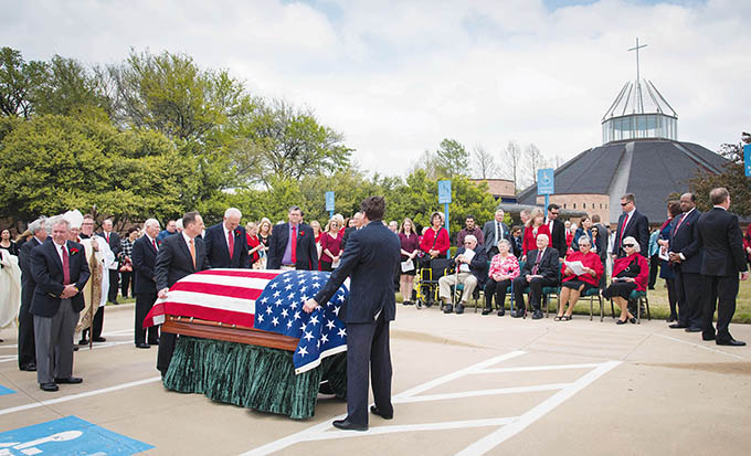 An American flag is draped over the casket of Msgr. Jim Balint, who served in the U.S. Air Force prior to being ordained as a priest in 1961, following the funeral Mass on March 29 at Prince of Peace Catholic Church in Plano. (RON HEFLIN/Special Contributor)