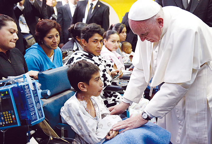 Pope Francis greets a sick child during a visit to the Federico Gomez Children's Hospital of Mexico in Mexico City Feb. 14. (CNS photo/Paul Haring)