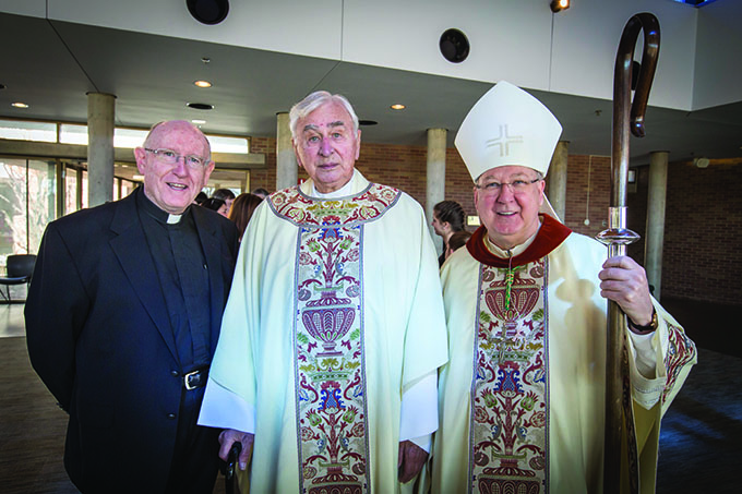 Bishop Kevin J. Farrell poses with Father Tom Clohery and Msgr. James Balint, the first pastor at Prince of Peace, after the 25th anniversary Mass of Prince of Peace Catholic Church in Plano on Feb. 7. (RON HEFLIN/Special Contributor)