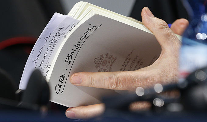"Cardinal Lorenzo Baldisseri, general secretary of the Synod of Bishops, holds his copy of Pope Francis' apostolic exhortation on the family, ""Amoris Laetitia"" (""The Joy of Love""), during a news conference for the release of the document at the Vatican April 8. The exhortation is the concluding document of the 2014 and 2015 synods of bishops on the family. (CNS photo/Paul Haring)"