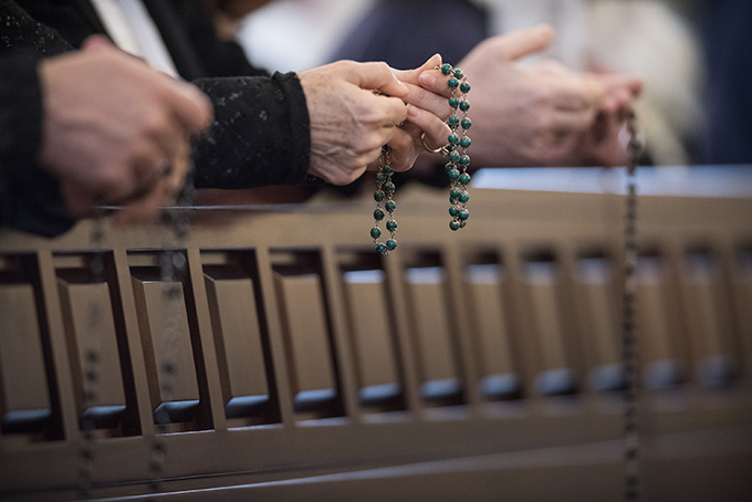 People pray the rosary at the the Shrine of the Most Blessed Sacrament in Hanceville, Ala. (CNS photo/Jeff Bruno, EWTN)