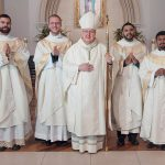 Bishop Kevin J. Farrell with 4 new priests for the Diocese of Dallas, from left, Father Paul Bechter, Emmett Hall, Ignacio Olvera Ortiz and Daniel Rendon in the Cathedral Shrine of the Virgin of Guadalupe May 21.