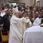 """Bishop Kevin J. Farrell incenses the casket of Msgr. Glenn """"Duffy"""" Gardner Jr. at the end of Mass on May 9 at St. Mark the Evangelist Catholic Church in Plano. (JENNA TETER/The Texas Catholic)"""