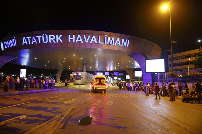 An ambulance is seen at Istanbul's Ataturk Airport following two explosions June 28. Turkish officials said at least 10 people were killed. (CNS photo/Osman Orsal, Reuters)