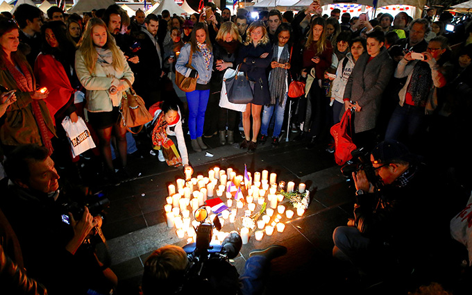 Members of the Australian French community stand around candles during a vigil in central Sydney July 15 to remember the victims of the Bastille Day truck attack in Nice, France. A truck loaded with weapons and hand grenades drove onto a sidewalk in Nice for more than a mile July 14, killing more than 80 people. (CNS photo/David Gray, Reuters)