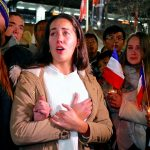 Members of the Australian French community mourn during a July 15 candlelight vigil in central Sydney to remember the victims of the Bastille Day truck attack in Nice, France. A truck loaded with weapons and hand grenades drove onto a sidewalk in Nice for more than a mile July 14, killing more than 80 people. (CNS photo/David Gray, Reuters)