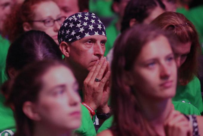 A U.S. World Youth Day pilgrim listens to Boston Cardinal Sean P. O'Malley speak July 27 at Tauron Arena in Krakow, Poland. (CNS photo/Bob Roller)