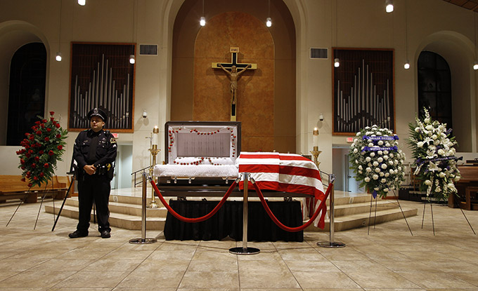 A lone officer stands watch over the body of Dallas Police Department Sgt. Michael Smith following a public visitation at Mary Immaculate Catholic Church in Farmers Branch on July 12. Sgt. Smith was one of five officers killed by a gunman following a protest July 7 in downtown Dallas. (KEVIN BARTRAM/Special Contributor)