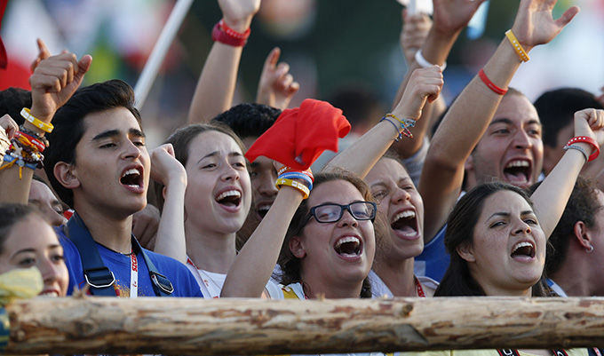 Pilgrims cheer after the Way of the Cross during World Youth Day in Blonia Park in Krakow, Poland, July 29. (CNS photo/Paul Haring)