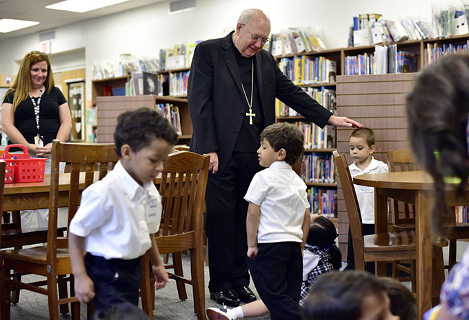 Bishop Kevin J. Farrell visits students at St. Philip & St. Augustine Catholic Academy on their first day of school on Aug. 12. (BEN TORRES/Special Contributor)