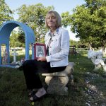 Vanna Slaughter holds a framed photograph of a statue of the Virgin Mary that at one time was located in Pecan Grove Cemetery in McKinney. The photograph remains a symbol of hope, faith and prayer for Slaughter, who hasn't let her 2010 sexual assault by an immigrant deter her from her role as the director of immigration and legal services for Catholic Charities of Dallas. (KEVIN BARTRAM/Special Contributor)