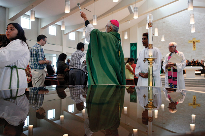 Father Timothy Gollob, far right, watches as Bishop Greg Kelly conducts a special blessing during a Mass celebrating the life and legacy of Sister Thea Bowman, on Saturday, Oct. 16, 2016 at Holy Cross Catholic Church in Dallas. (Ben Torres/Special Contributor)