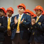 Student Jacob Conners, middle, applauds during a groundbreaking event for a new academic building Oct. 14 at Cristo Rey Dallas College Prep. (JENNA TETER/The Texas Catholic)