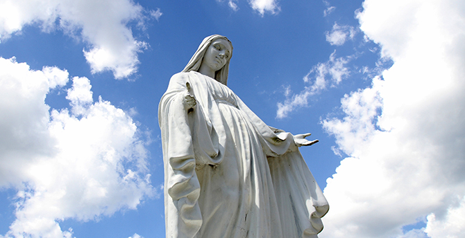 A statue of Mary overlooks the grounds of St. Jude Church in Mastic Beach, N.Y., Aug. 4. (CNS photo/Gregory A. Shemitz)