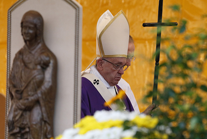 Pope Francis leaves after celebrating Mass in Rome's Prima Porta cemetery Nov. 2, the feast of All Souls. (CNS photo/Paul Haring)