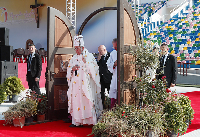 Pope Francis walks through a Holy Door as he arrives to celebrate Mass at Mikheil Meskhi Stadium in Tbilisi, Georgia, Oct. 1. (CNS photo/Paul Haring)