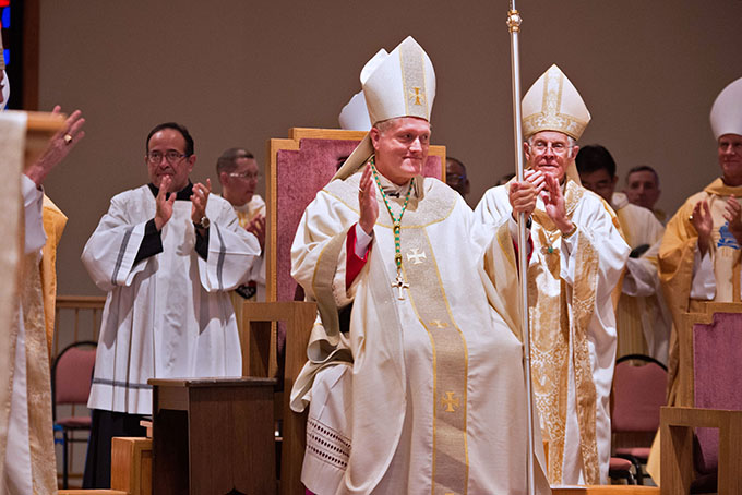 Bishop Robert Coerver receives a standing ovation after being ordained a bishop and installed as the third bishop of Lubbock on Nov. 21 at the Cathedral of Christ the King. (JENNA TETER/The Texas Catholic)