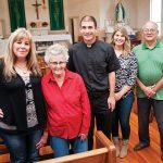 Father James Yamauchi, middle, with St. Martin of Tours Catholic Church parishioners, from left, Julie Shuler, Paula Pokladnik, Jacy Wright and John Mastervich. (JENNA TETER/The Texas Catholic)