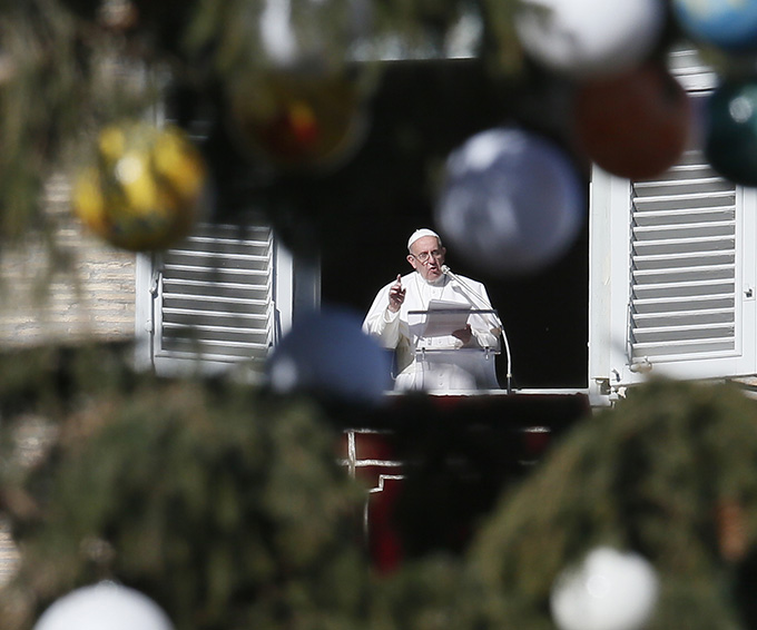 Pope Francis leads the Angelus from his studio overlooking St. Peter's Square at the Vatican Jan. 6, the feast of the Epiphany. (CNS photo/Paul Haring)