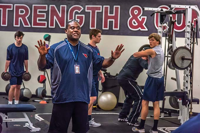 John Paul II football coach George Teague works with the team in the weight room at the school in Plano, Texas, Tuesday, Jan. 10, 2017. (Ron Heflin)