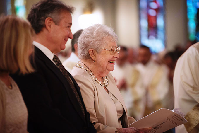 Geraldine Burns smiles at her son, Bishop Edward J. Burns, from her seat during the sign of peace at his Rite of Installation Mass as the eighth bishop of Dallas Feb. 9 at the Cathedral Shrine of the Virgin of Guadalupe. (JENNA TETER/The Texas Catholic)