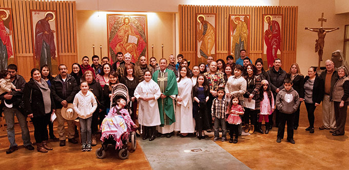 Father Michael Galbraith with the Hispanic Ministry group at St. Paul Catholic Church in Juneau, Alaska on Jan. 22. (JENNA TETER/The Texas Catholic)