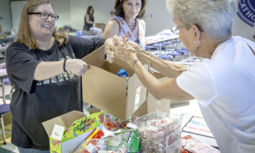 Prince of Peace group gathers care packages for troops