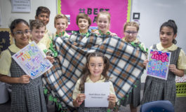 Students work together to make blankets for veterans
