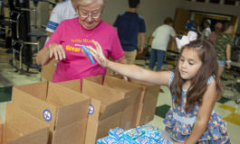 Parishioners, students pack boxes for 'Heroes'